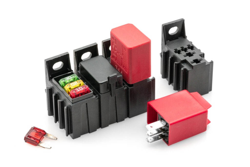 Relay/mini fuse/timers (modular base holder)